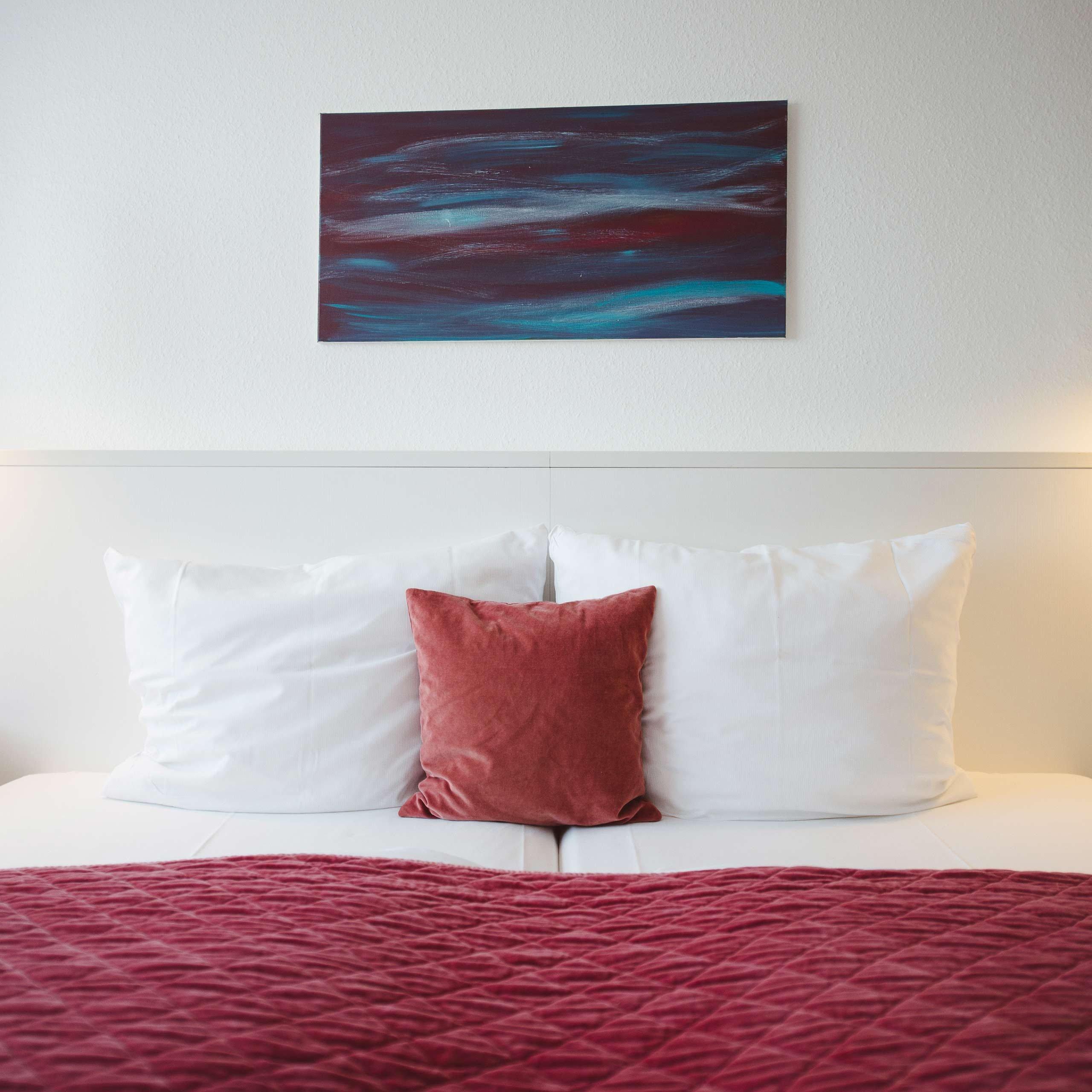 Gemütliches Bett im meerzeit Hotel